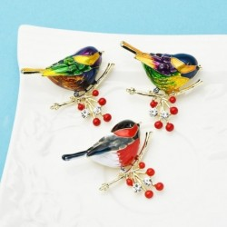 A bird sitting on a branch - crystal brooch