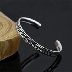 Stainless steel bracelet - with leaf pattern - open design - unisex